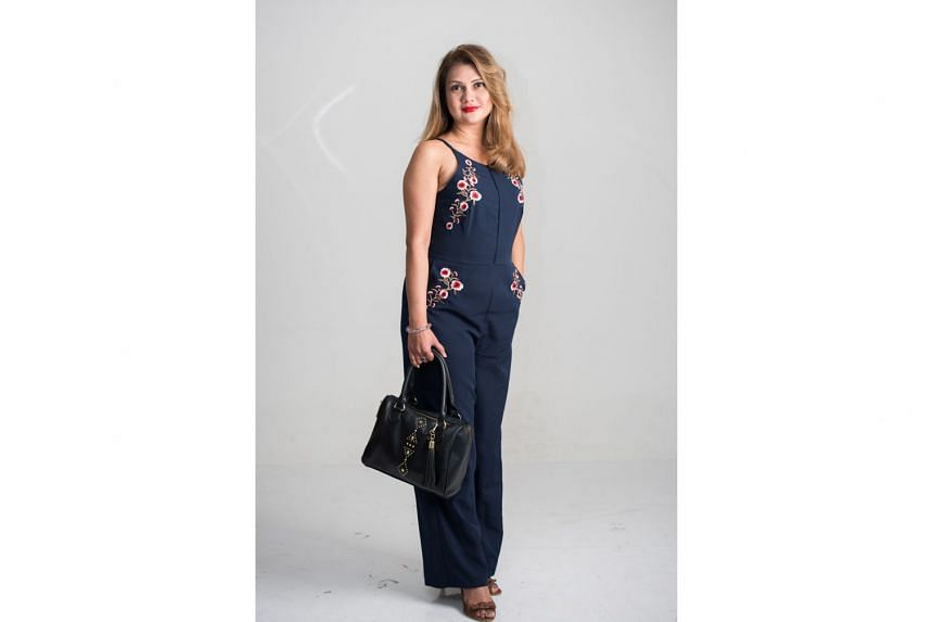 ON HER BAG: I got this Steve Madden bag while on vacation in Florida about two years ago. It's the perfect abbreviated car boot, which is my real bag, where I have clothes and numerous pairs of shoes. I like that the bag is neat and compact and gives