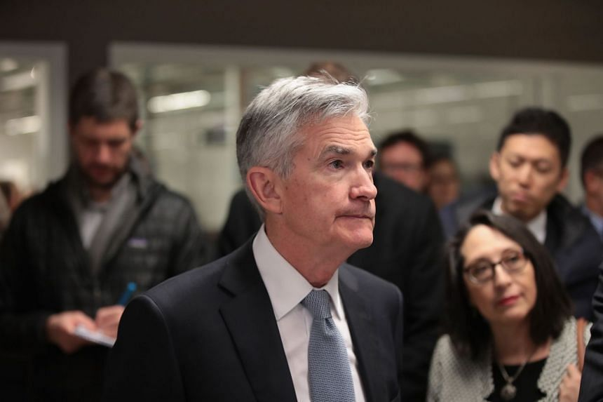 Federal Reserve chairman Jerome Powell touring a facility to help entrepreneurs in Chicago.