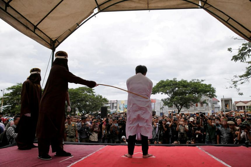 An Indonesian man is publicly caned for having gay sex in Banda Aceh, Aceh province, Indonesia, on May 23, 2017.