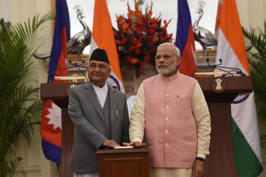 Indian Prime Minister Narendra Modi (right) and Prime Minister of Nepal K.P. Sharma Oli at the inauguration of India-Nepal petroleum products pipeline and the Integrated Check Post, at Hyderabad house, in New Delhi on April 7, 2018.