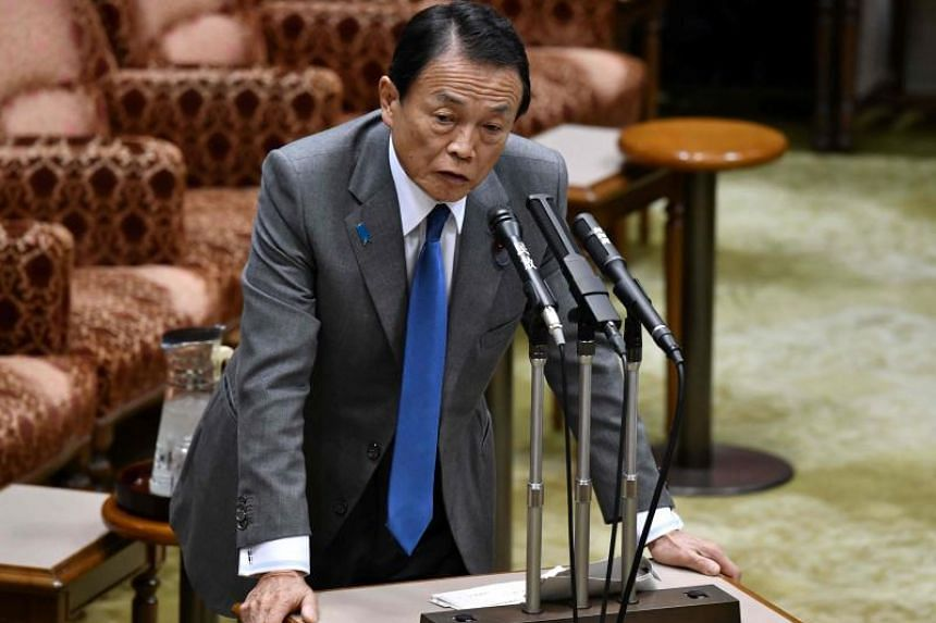 Japan's finance minister Taro Aso answers questions during a budget committee session of the upper house in Tokyo on March 19, 2018.