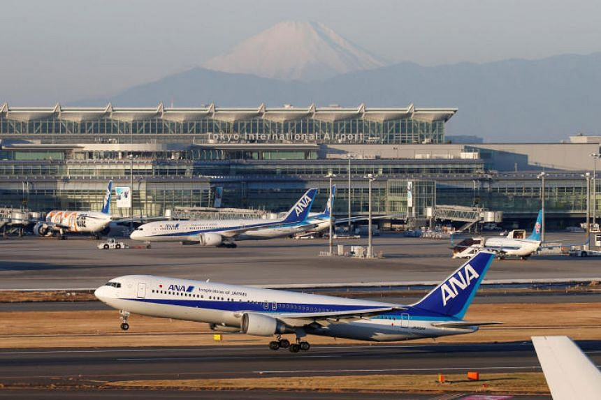 All Nippon Airways (ANA) Boeing 767 takes off in front of Mount Fuji at the Tokyo International Airport, commonly known as Haneda Airport, in Tokyo, Japan on Jan 10, 2018.