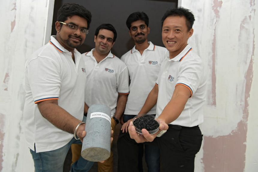 (From left) Research assistant Chakradhar Pedapati, PHD student Souradeep Gupta, research assistant Manikandan Jayaraj and associate professor Dr Kua Harn Wei with a biochar and a concrete column containing biochar.