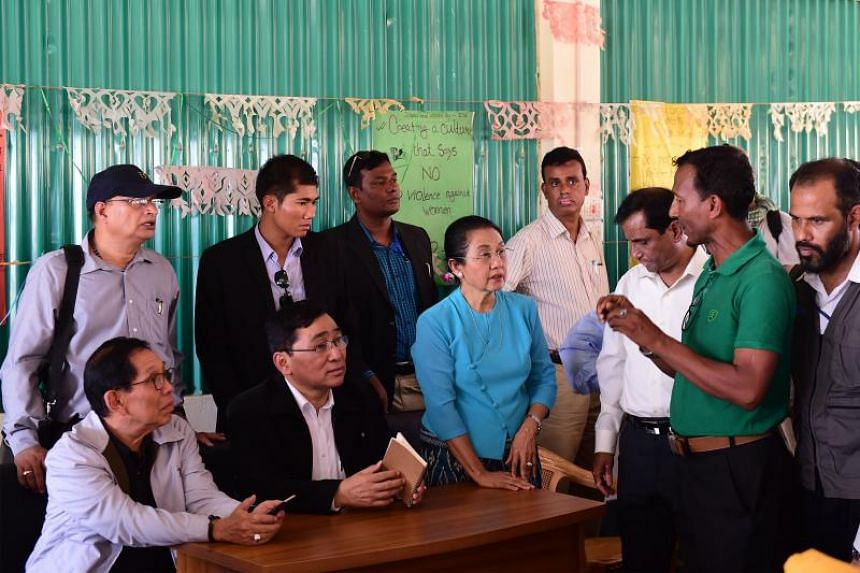 Myanmar Social Welfare Minister Win Myat Aye (front second from left) told about 50 Rohingya refugees in Bangladesh on April 11 that getting the repatriation process moving was top priority.