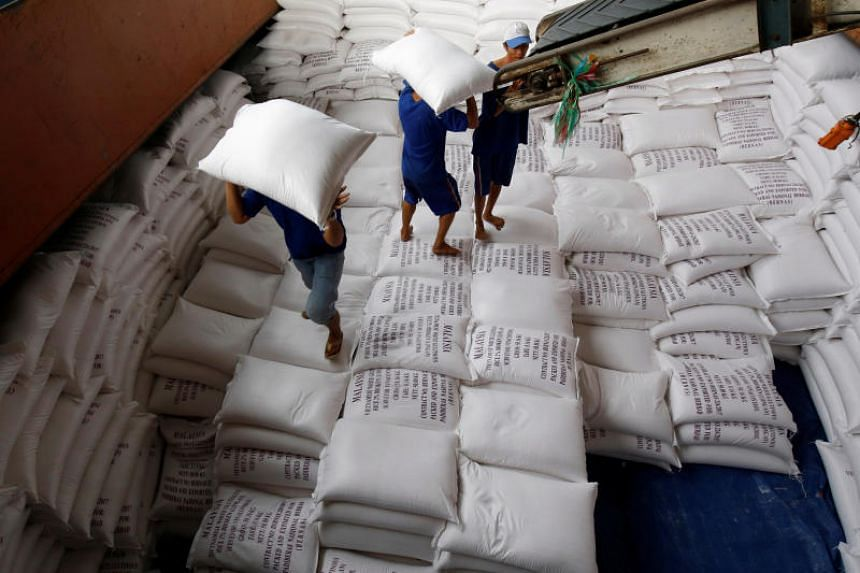 Men loading rice for export at a factory in Vietnam's Mekong delta. Analysts are warning that a trade war between China and the US will adversely affect economies in South-east Asia.
