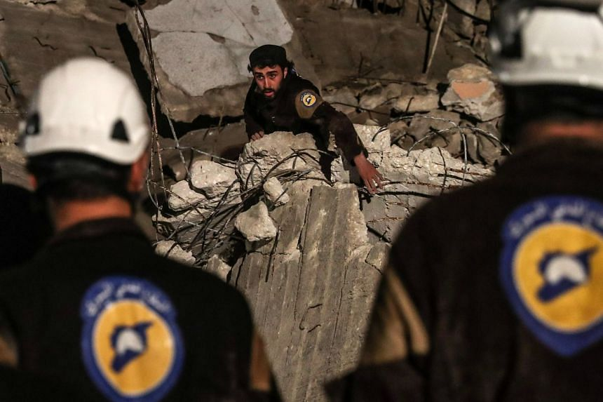 White Helmet volunteers search for survivors after an explosion in Idlib, Syria, on April 9, 2018.