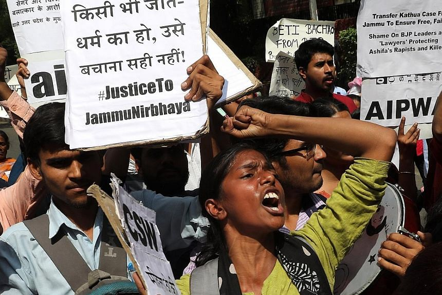 Indian activists in New Delhi yesterday protesting against the alleged rapes.