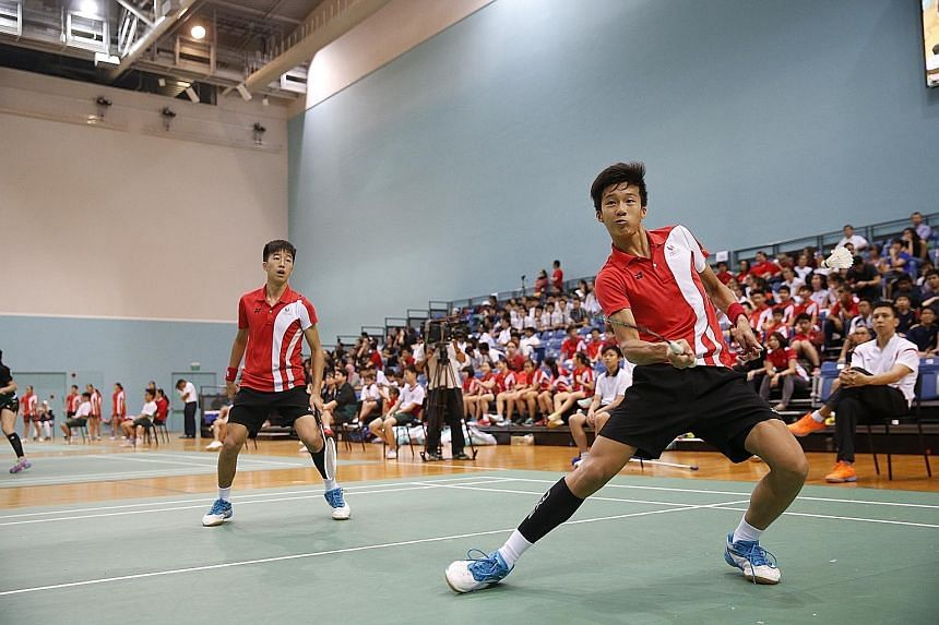 Singapore Sports School's Junsuke Kubo (left) and Wesley Koh competing in the doubles. The B Division boys beat ACS (I) 5-0.
