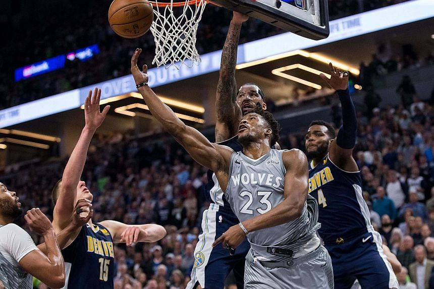 Minnesota forward Jimmy Butler taking a shot against Denver at Target Centre. His team will play Houston in the first round of the play-offs.
