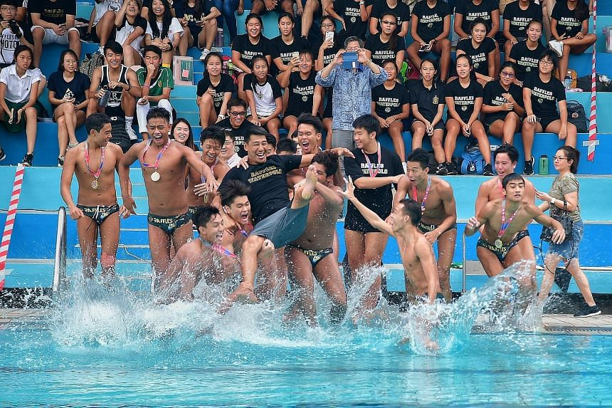 Raffles Institution (RI) water polo players celebrate winning the Schools National A Division boys' title by throwing coach Yu Lei into the pool. The defending champions beat Anglo-Chinese School (Independent) 5-4 at the MOE (Evans) Swimming Complex