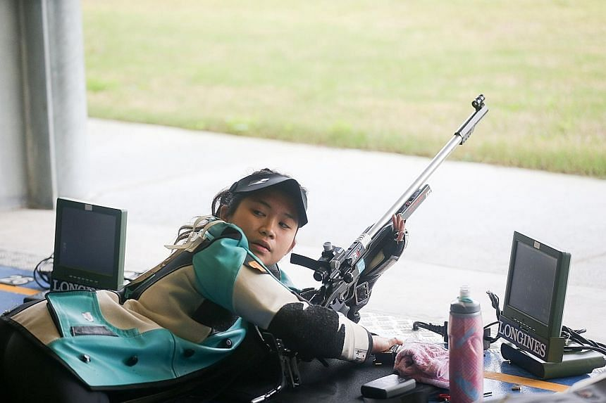 Martina Veloso in between shots during the 50m rifle prone event at the Gold Coast Commonwealth Games. She went out to have fun as it was probably her last attempt in this event as it is not offered in the Olympics.