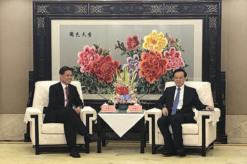 Minister in the Prime Minister's Office Chan Chun Sing (left) meeting Chongqing party boss Chen Min'er yesterday in the south-western Chinese city of Chongqing, where they noted the potential to deepen collaboration.