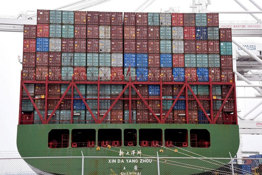 Shipping containers being loaded onto Xin Da Yang Zhou ship from Shanghai, China at Pier J at the Port of Long Beach in Long Beach, California, US, on April 4, 2018.