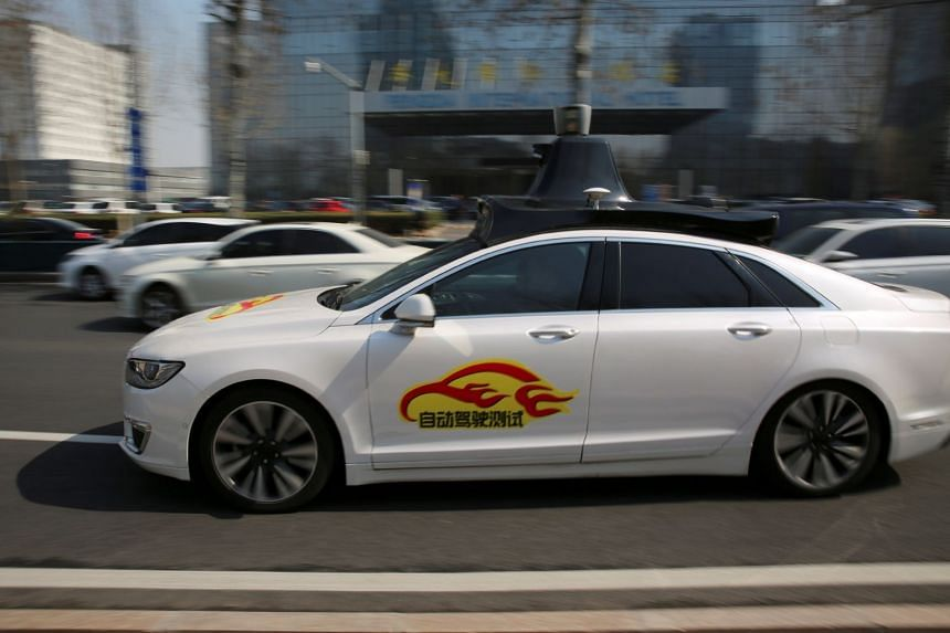A Baidu's Apollo autonomous car is seen during a public road test for self-driving vehicles in Beijing, China on March 22, 2018.  P