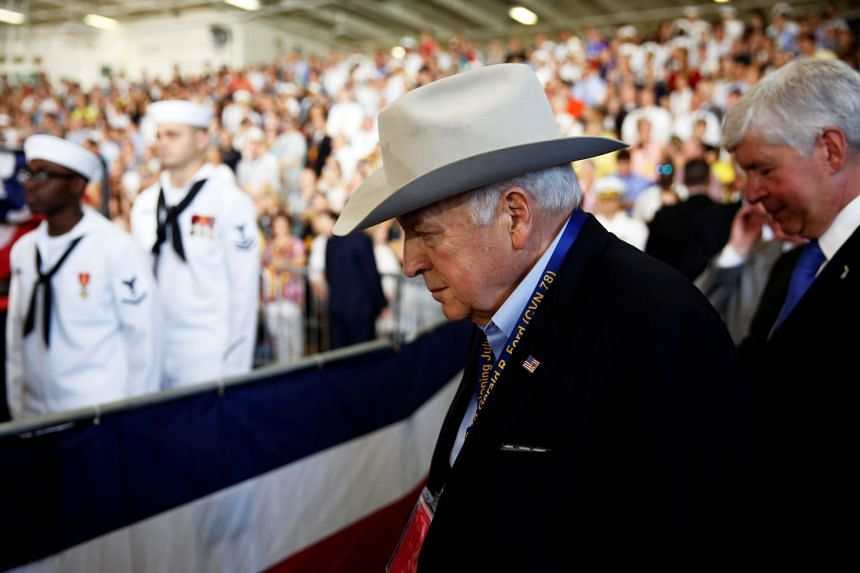 Former US Vice-President Dick Cheney attends the commissioning ceremony aboard the aircraft carrier USS Gerald R. Ford at Naval Station Norfolk in Norfolk, Virginia on July 22, 2017.