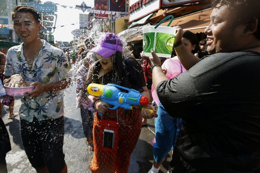 Crowded water-gun battles that leave revellers soaked are a distinctive feature of the Songkran celebrations, prompting a Thai government official to warn women against wearing revealing outfits.