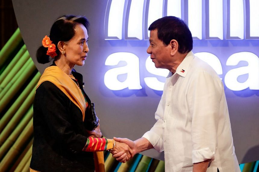 Philippine President Rodrigo Duterte shakes hands with Myanmar leader Aung San Suu Kyi before the opening ceremony of the 31st Association of Southeast Asian Nations Summit in Manila, Philippines on Nov 13, 2017.