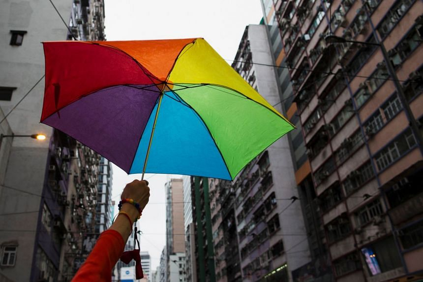 A file photo of a participant holding a rainbow umbrella as he attends a lesbian, gay, bisexual and transgender (LGBT) Pride Parade in Hong Kong, on Nov 8, 2014.