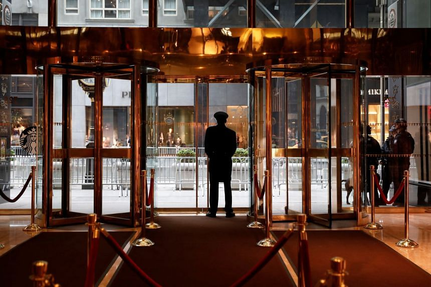 A doorman stands by the 5th Avenue entrance to the lobby inside Trump Tower in New York Cit on April 25, 2017.