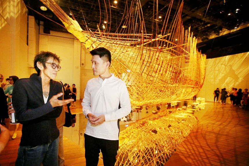 Artist Zai Kuning (left) discussing the artwork, Dapunta Hyang: Transmission Of Knowledge, with Parliamentary Secretary Baey Yam Keng, at the opening of the exhibition in Mohamed Sultan Road yesterday. The 17m-long skeletal ship was built for Singapo
