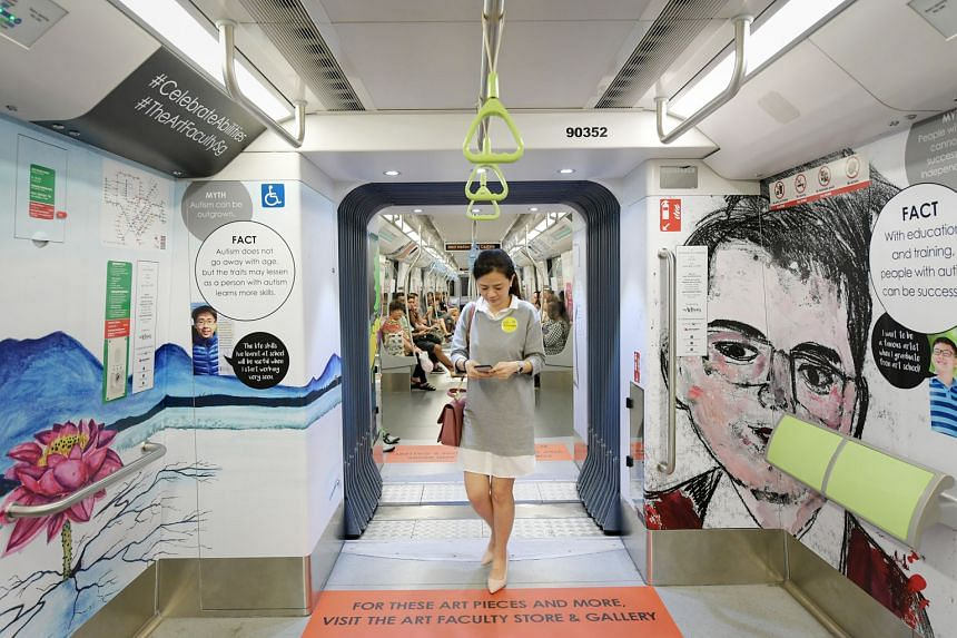 A woman walking by works of art by Ng Li Jie, 21, (on the left), and Sean Bay, 22, on a Downtown Line train. Choo Jian Wei (below left), 17, with his sketch on the same train.