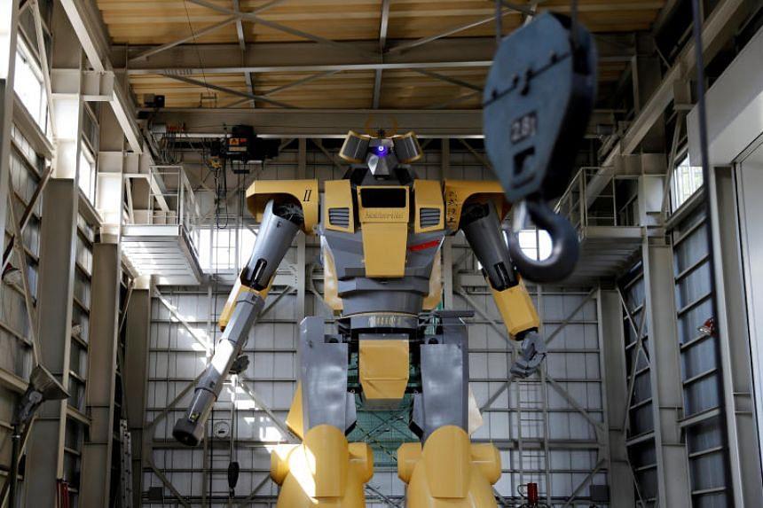 Sakakibara Kikai's bipedal robot Mononofu is pictured during its demonstration at its factory in Shinto Village, Gunma Prefecture, Japan.