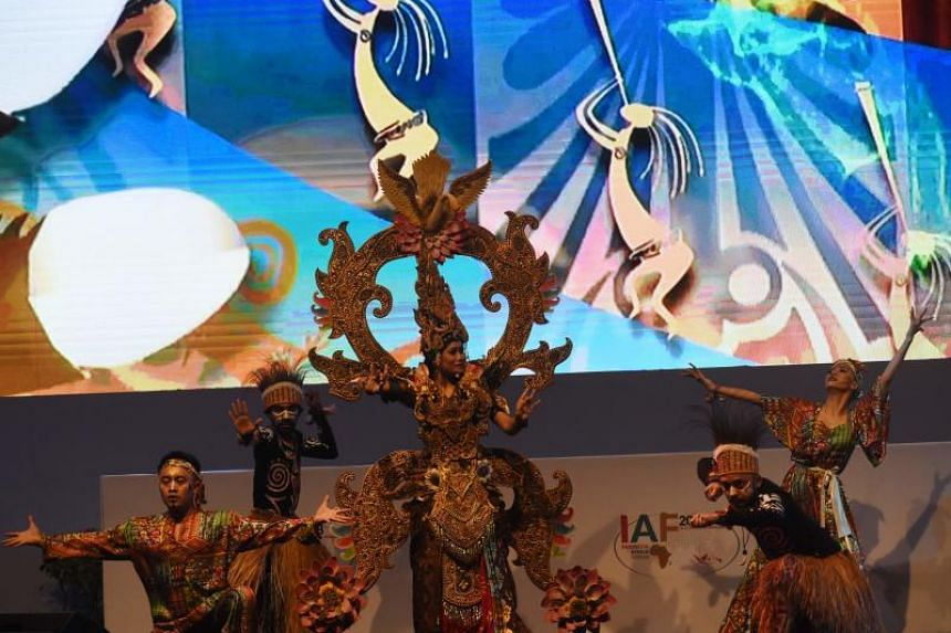 Indonesia dancers perform a traditional dance during the opening of the Indonesia Africa Forum (IAF) 2018 in Nusa Dua, in Bali on April 10, 2018.