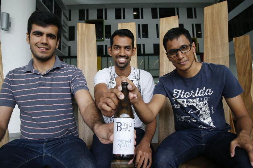 (From left) Heetesh Alwani, 24, Immandira Rahul, 24, and Abilash Subbaraman, 24,  brewed beer in a hall in Nanyang Technological University (NTU) but were stopped after the school found out about it.
