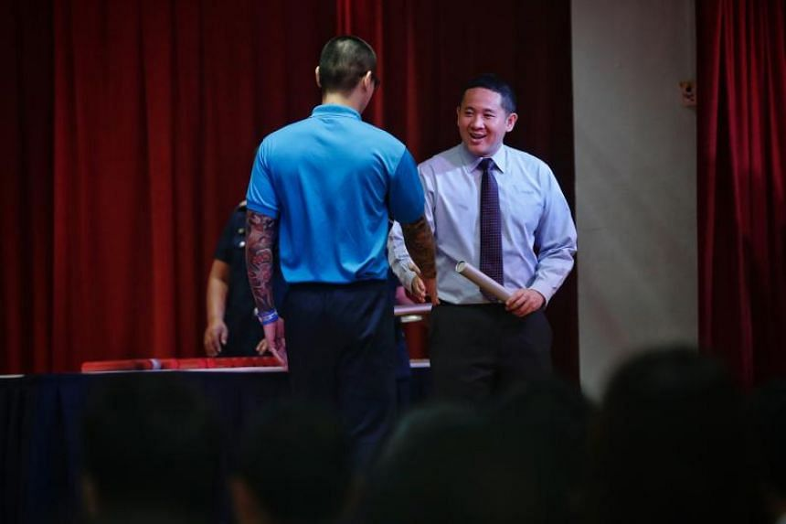 Inmate John (not his real name) receives his silver award from Parliamentary Secretary for Ministry of Home Affairs and Ministry of Health Amrin Amin at the National Youth Achievement Awards Presentation Ceremony 2018 at Tanah Merah Prison on April 1