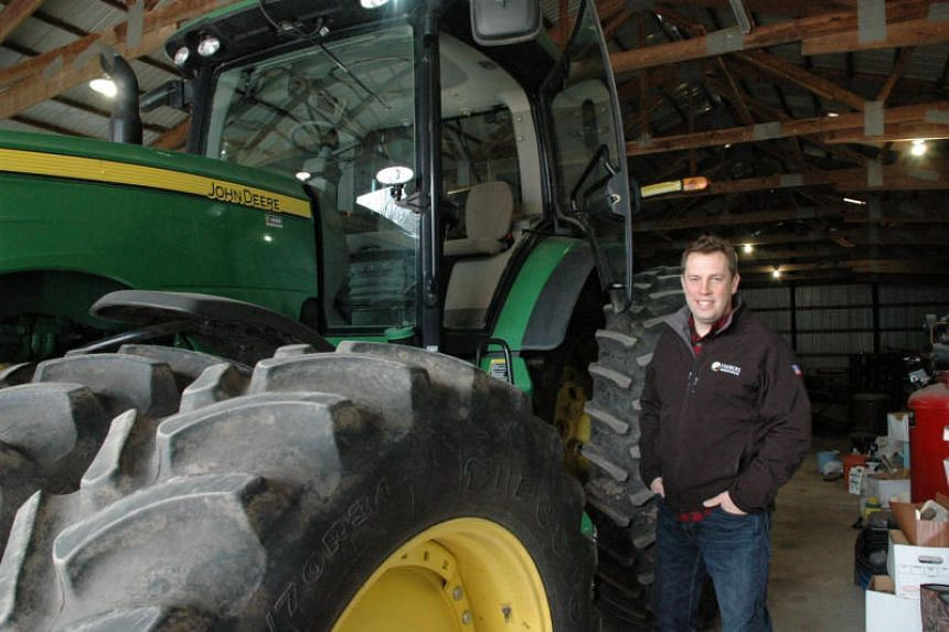 Illinois grain farmer Lucas Strom checks on his tractor inside his barn in unincorporated Kane County, Illinois, US on April 10, 2018.