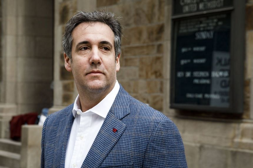 Michael Cohen walks from his hotel to his apartment in New York, April 12, 2018.