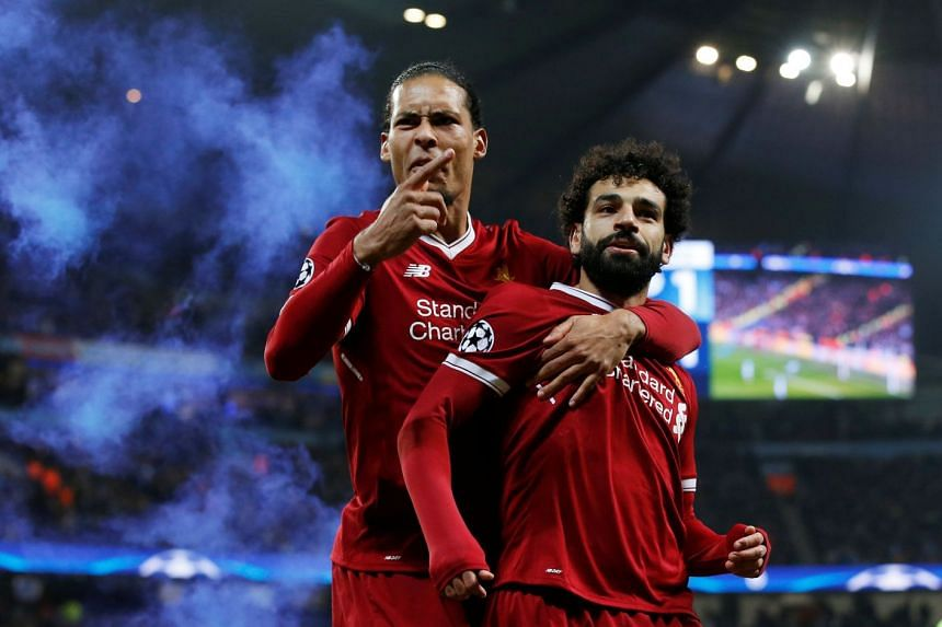 Salah celebrates scoring against Manchester City in the Champions League with Virgil van Dijk.