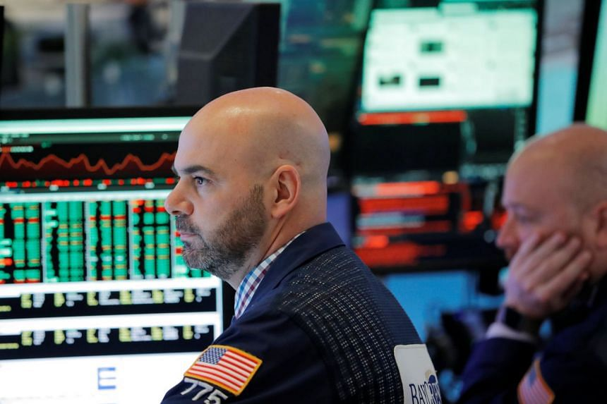 Traders working on the floor of the New York Stock Exchange ahead of opening on April 12, 2018.