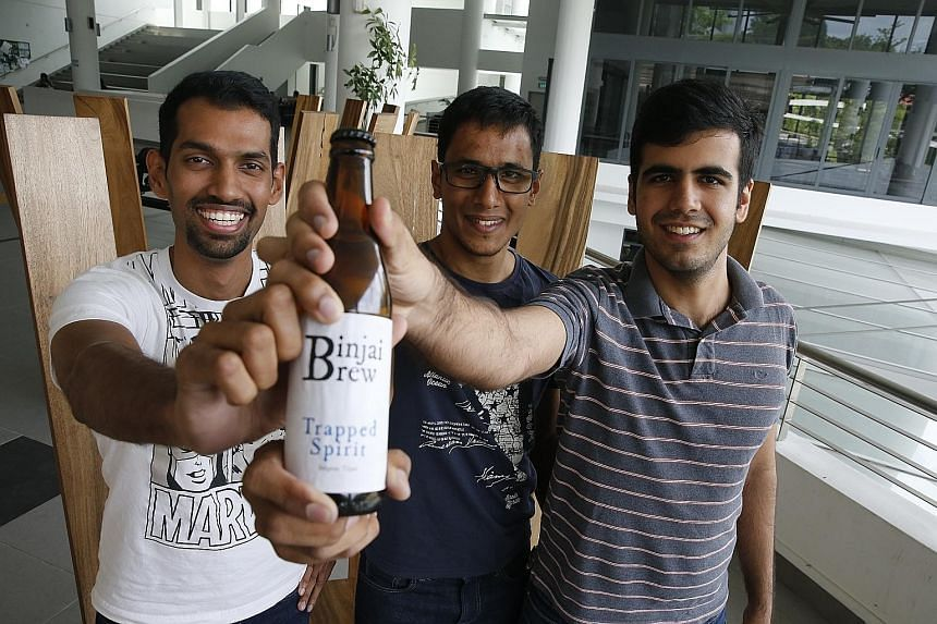 """(From left) NTU engineering students Rahul Immandira, Abilash Subbaraman and Heetesh Alwani, makers of the """"Binjai Brew"""", built from scratch a """"cold box"""" - a fridge that controls the temperature of the beer as it ferments. In total, they spent about"""