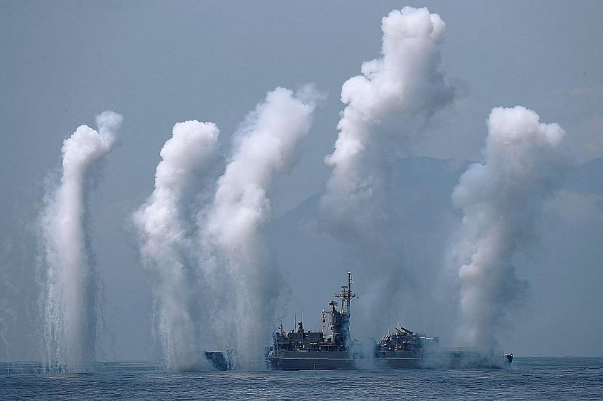 Flares being set off from Taiwanese frigate Fong Yang during a drill yesterday near Yilan naval base, in the east. Amid rising tensions with Beijing, Taiwanese President Tsai Ing-wen presided over the military drill by the island's navy for the first