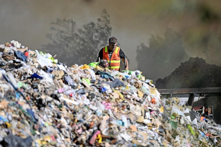 Firefighters attending to a blaze at a waste recycling centre in Melbourne yesterday. Australia has long relied on China as the chief importer of its recyclable materials, including paper, plastics and metals.