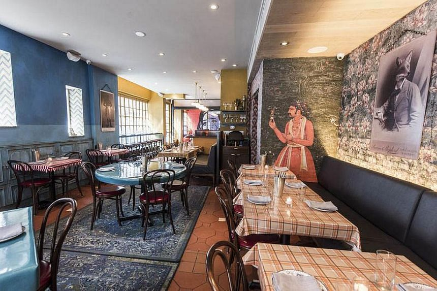 The subterranean space at New York eatery Bond 45 (above) has the vibe of an Italian patio, while Bombay Bread Bar (left) has a bright, cheery ambience.