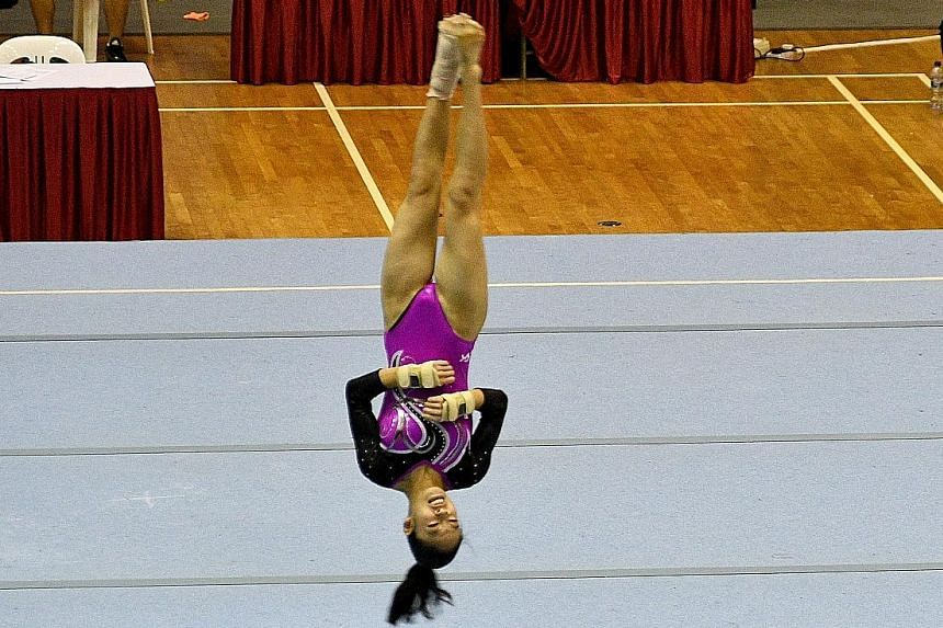 Shayne Tan of Nanyang Girls' High School during her floor exercise at the Schools National Gymnastics Championships yesterday. She won all the individual events on offer.