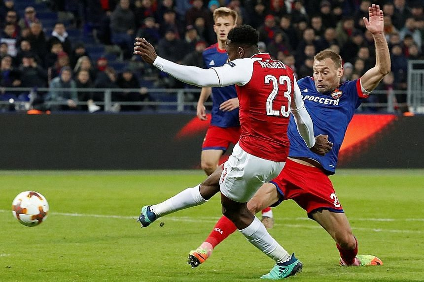 Danny Welbeck scoring Arsenal's first goal against CSKA in Moscow on Thursday. They drew 2-2 but Arsenal went through to the semis 6-3 on aggregate.