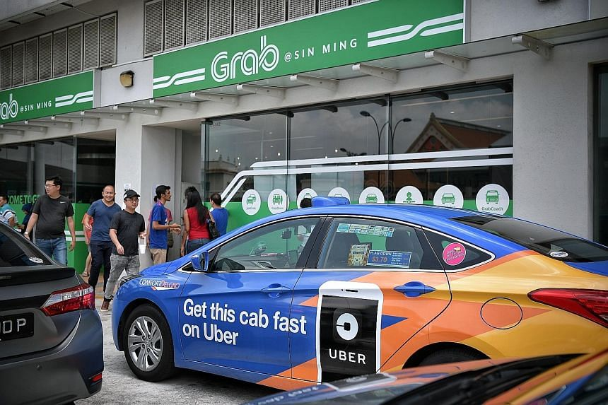 """Grab's office in Midview City. Grab said last week that """"thousands"""" of Uber drivers had signed up with the Singapore-based firm following the announcement of its deal with Uber."""