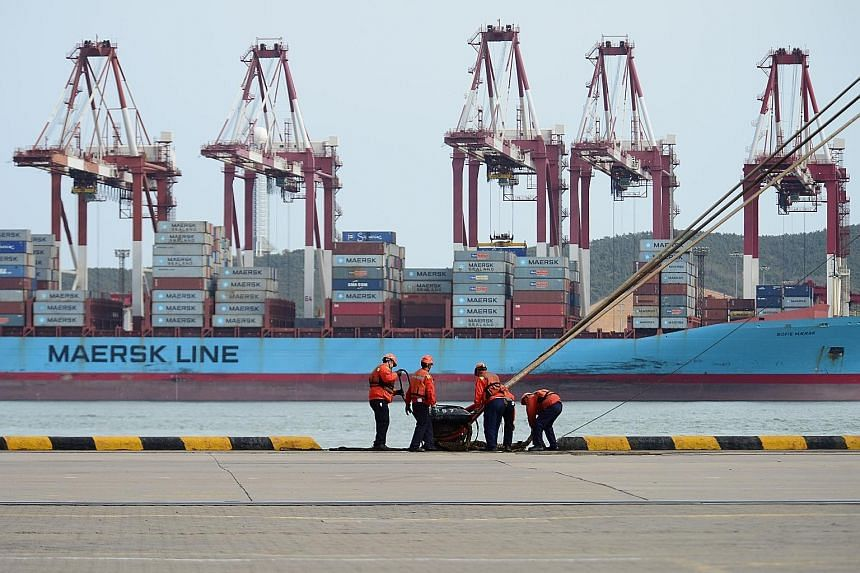 Workers at a port in Qingdao, in China's Shandong province. China's trade surplus with the US in the first quarter rose 19.4 per cent year on year to $76 billion.