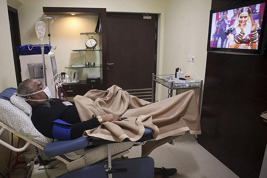 A patient at a dialysis centre of Fortis Healthcare (India) in New Delhi. Fortis Healthcare is India's second-largest private hospital chain.