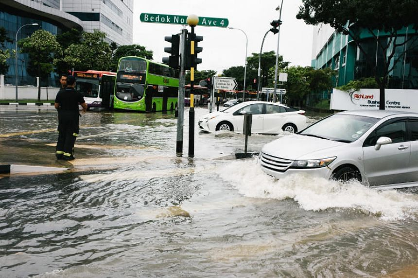 Vehicles at the flooded junction of Upper Changi Rd and Bedok North Avenue 4 on Jan 8, 2018.