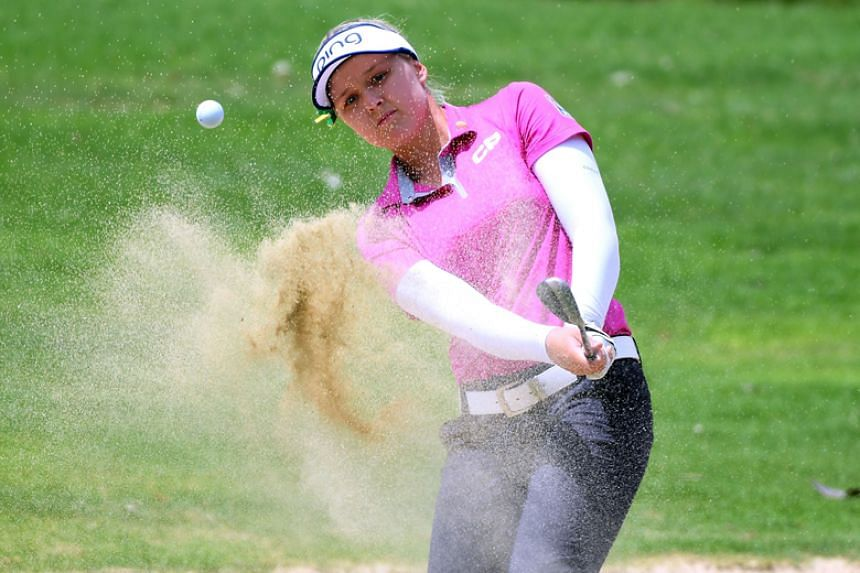 Brooke Henderson\ hits out of a bunker on the fourth hole during the third round of the LPGA Lotte Championship at the Ko Olina Golf Club in Hawaii on April 13, 2018.