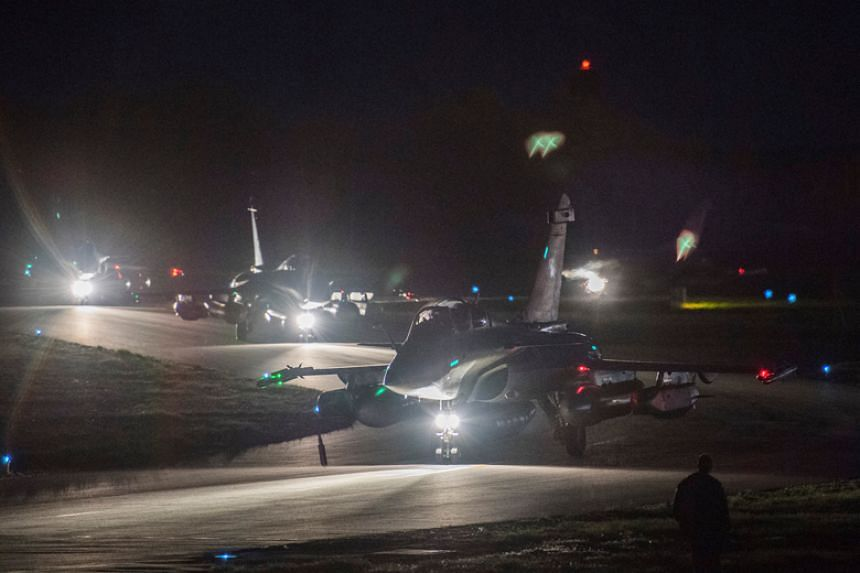 French Rafale fighter jets prepare to take off on April 13, 2018, from the Saint-Dizier military base in France.