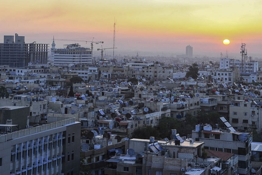 The sun rises over the Syrian capital Damascus on April 14, 2018.