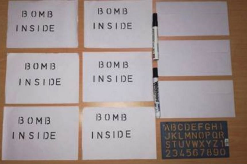 """Albert Pang Tze Kaan allegedly mailed an envelope - with a letter in it which read """"Bomb Inside"""" - to Parliament House."""