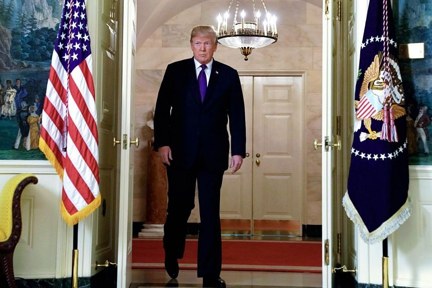US President Donald Trump arrives to announce military strikes on Syria during a statement at the White House, on April 13, 2018.