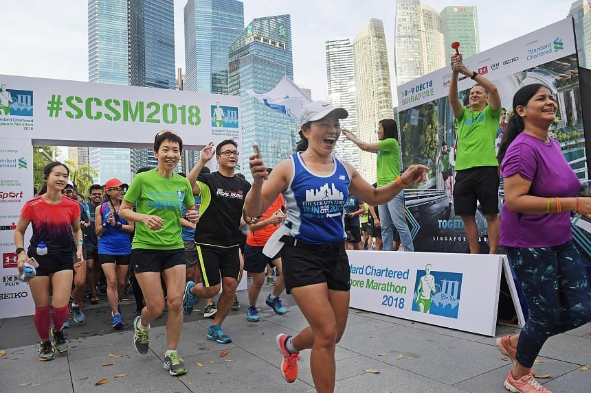 Minister for Culture, Community and Youth Grace Fu (second from left) leading participants on the 4km community run, on April 14, 2018.