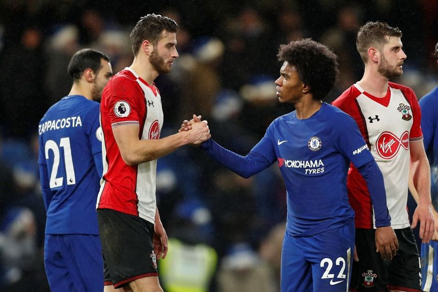 Chelsea's Willian shakes hands with Southampton's Wesley Hoedt at the end of the match.